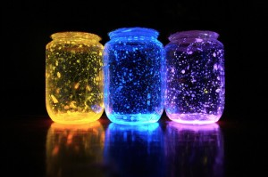 Three colored glowing jars