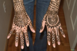 Complicated Mehndi Design on Hand Top