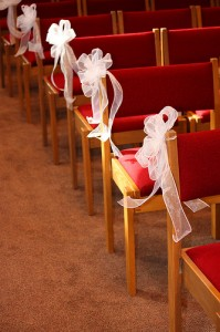 Ribbon Decoration to Inner Aisle Chairs 199x300 Simple and Effective Wedding Aisle Decorations