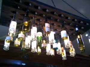 9 Bottle Chandelier 300x225 35 Home DIY Projects That Won't Fail To Inspire You