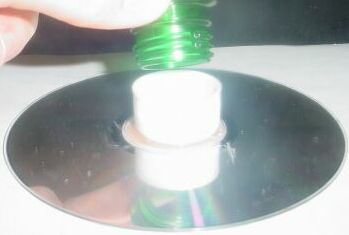 Glue CD with Cap and Cap the Bottle